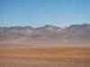 De bijzondere kleuren van de enorme bergen ver weg komen niet helemaal uit de verf
